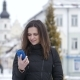 Attractive Beautiful Girl Is Talking on the Phone in the City Center. Winter - VideoHive Item for Sale