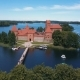 Aerial Drone Shot of Trakai Castle in Lithuania. Flight Over Trees. Beautiful Castle on the Lakes - VideoHive Item for Sale