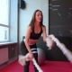 Young Adult Girl Practising Battle Rope Exercise During a Crossfit Workout at the Gym - VideoHive Item for Sale