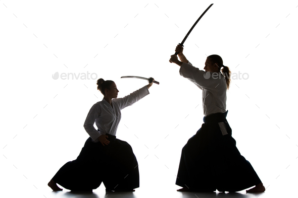 Man and woman fighting and training aikido on white studio background - Stock Photo - Images