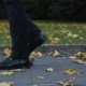 Male Legs Walks on the Pavement with Golden Autumn Leaves - VideoHive Item for Sale