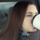 Woman Drinks Coffee in Car - VideoHive Item for Sale