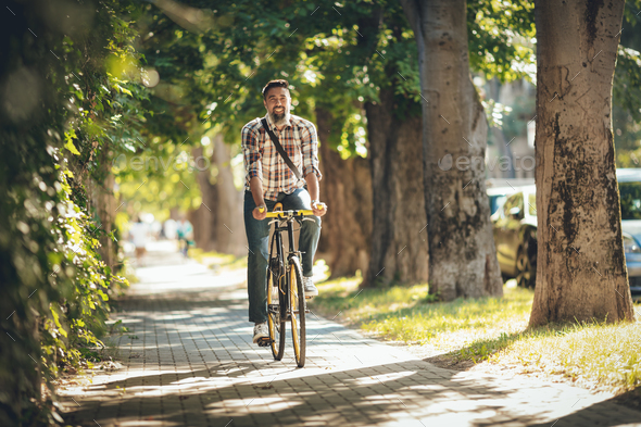 Handsome Man Riding Bicycle - Stock Photo - Images