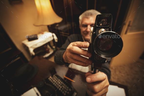 Senior Man Holding Video Camera - Stock Photo - Images