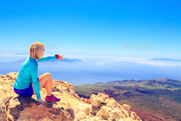 Woman looking at inspirational landscape - Stock Photo - Images