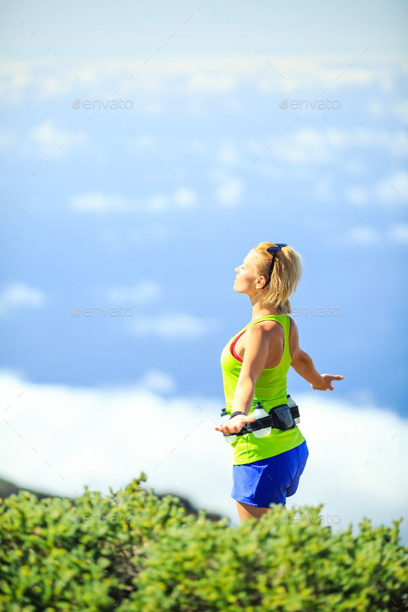 Happy woman runner arms raised outstretched - Stock Photo - Images