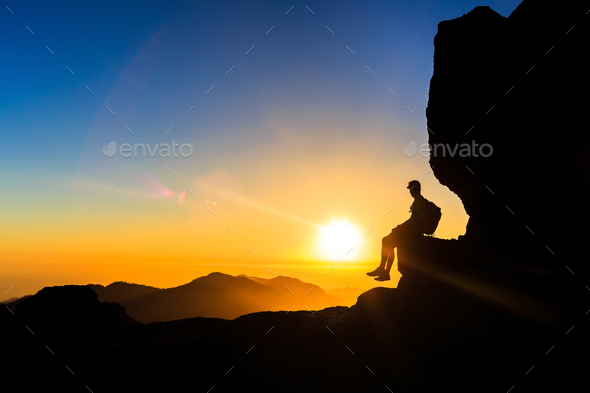 Man hiking silhouette in mountains sunset freedom - Stock Photo - Images