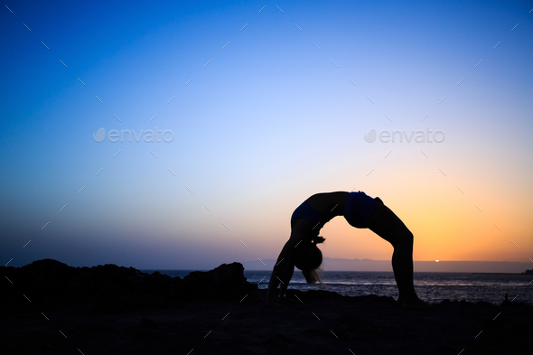 Woman stretches yoga sunset silhouette - Stock Photo - Images