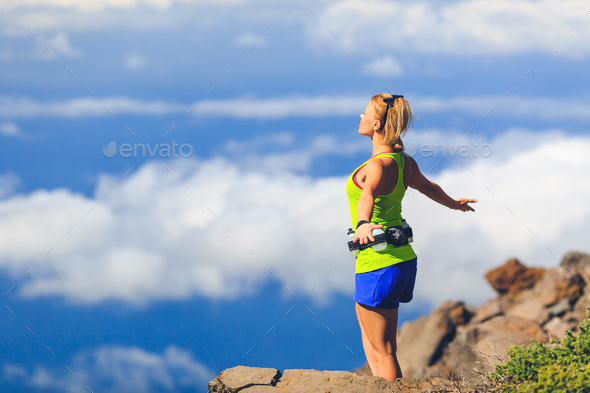 Happy woman runner arms raised outstretched freedom - Stock Photo - Images