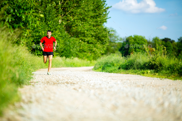 Man running jogging on country road - Stock Photo - Images