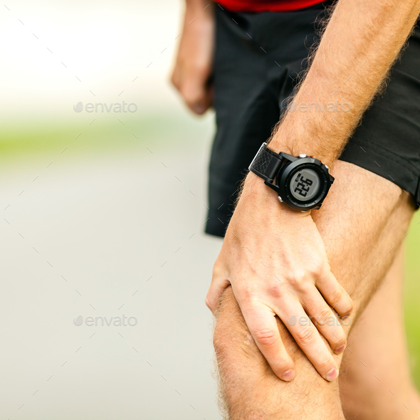 Knee pain running injury - Stock Photo - Images