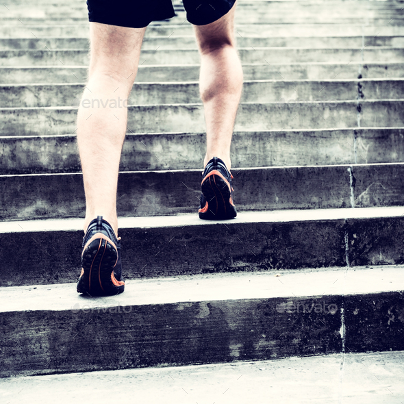 Jogger running on stairs sports training - Stock Photo - Images