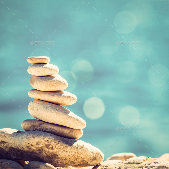 Stones balance, vintage pebbles stack background - Stock Photo - Images