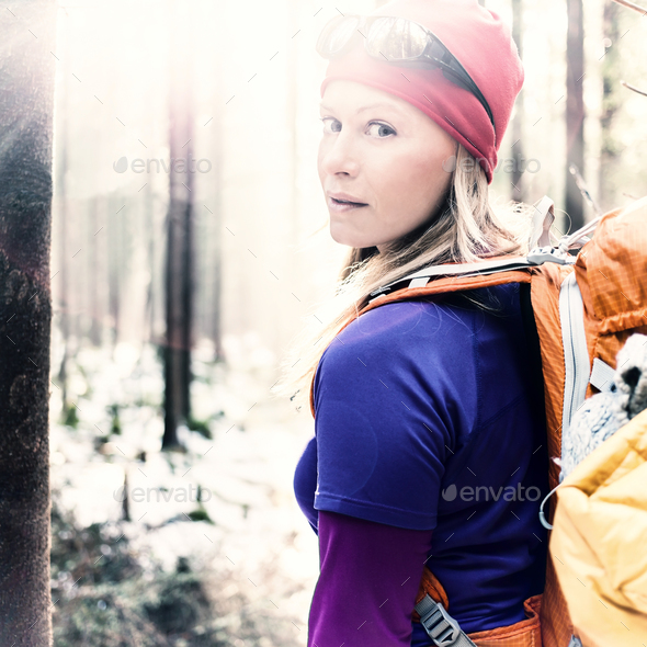Woman hiking camping in vintage winter forest sunlight - Stock Photo - Images