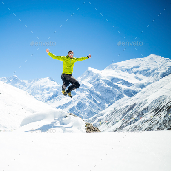 Happy man jumping success in mountains - Stock Photo - Images