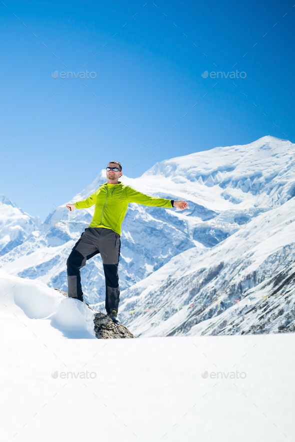 Happy man hiker winter in mountains - Stock Photo - Images