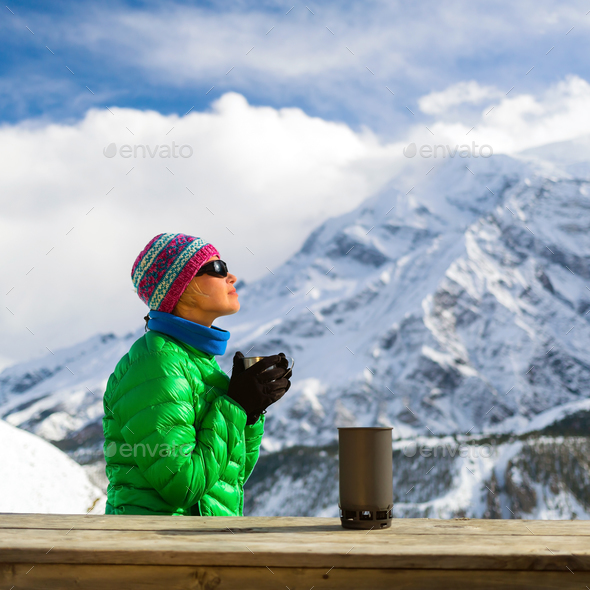 Woman drinking camping in mountains - Stock Photo - Images