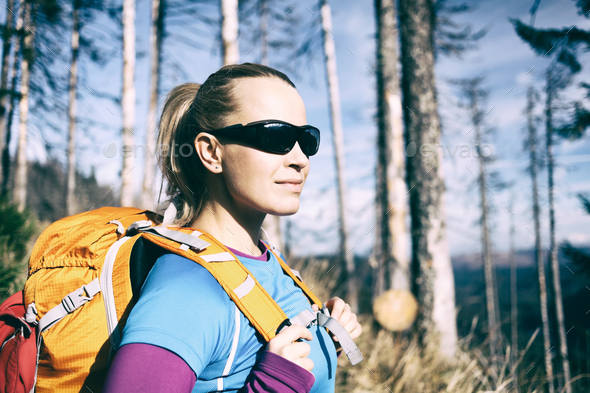 Woman hiking in winter autumn forest - Stock Photo - Images