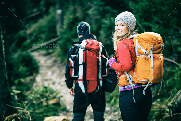Couple hikers walking in mountains - Stock Photo - Images