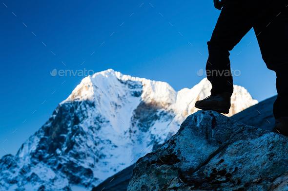 Man hiking in Himalaya Mountains - Stock Photo - Images