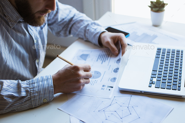 Man working on laptop computer - Stock Photo - Images