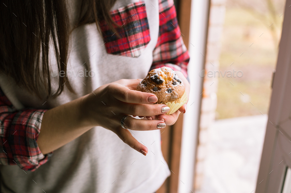 Muffin on girl hands. Close up. - Stock Photo - Images