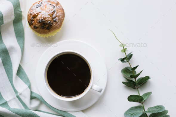Coffee and muffin on white background - Stock Photo - Images