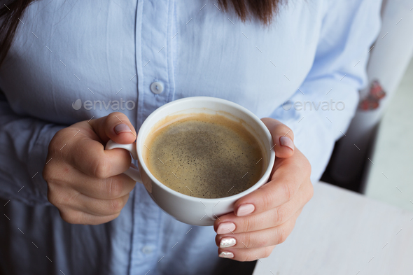 Female hands with coffee drink - Stock Photo - Images