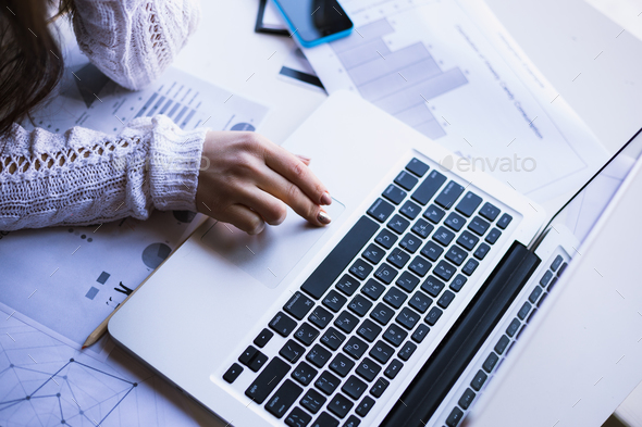 Girl using her laptop in her house. - Stock Photo - Images