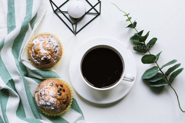 Coffee and two muffins on white background - Stock Photo - Images