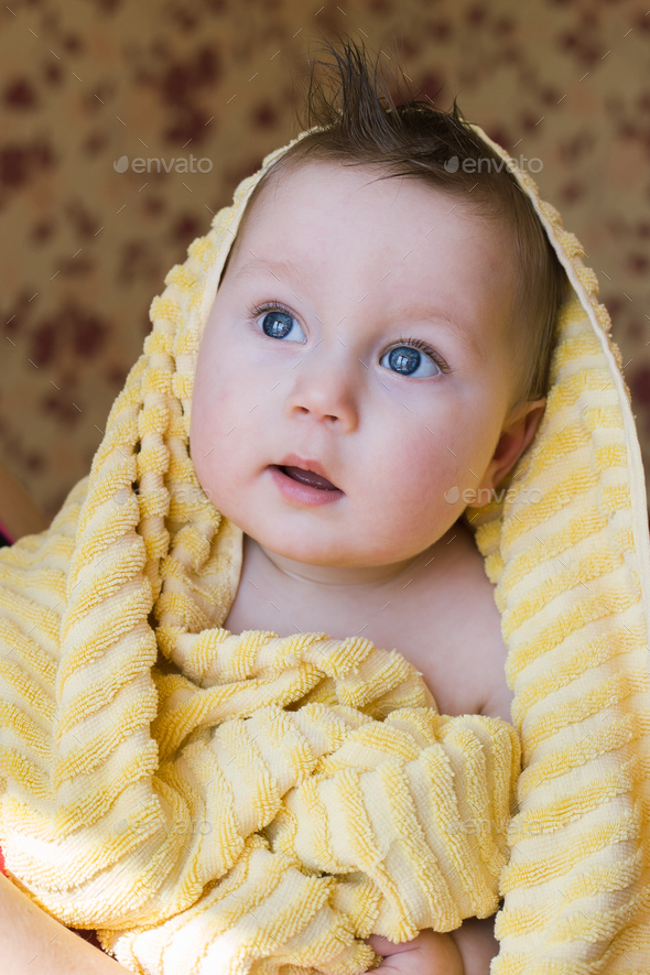 Mother and baby child after shower. Baby covered in bath towel - Stock Photo - Images