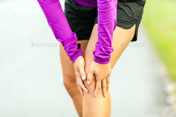 Physical injury, running knee pain - Stock Photo - Images