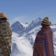Two Women in Woolen Blankets Stand and Look at the Mountains - VideoHive Item for Sale