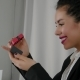 Excitedly, a Young Woman Opens a Gift - VideoHive Item for Sale