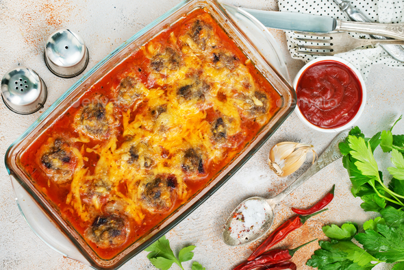baked meatballs with sauce - Stock Photo - Images
