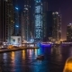 Beautiful View of the Skyscrapers of Dubai Marina with Bright Night Illumination and a Water Canal - VideoHive Item for Sale