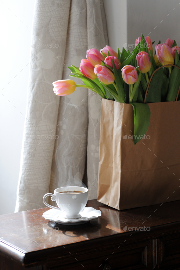 Cup of coffee and beautiful tulips - Stock Photo - Images