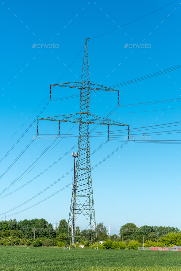 Power supply lines and electric pylons  - Stock Photo - Images