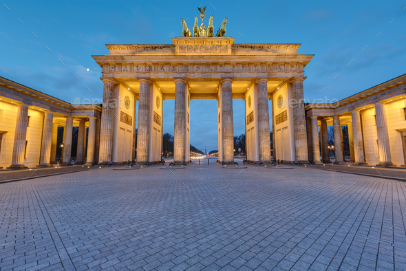 The illuminated Brandenburg Gate in Berlin - Stock Photo - Images
