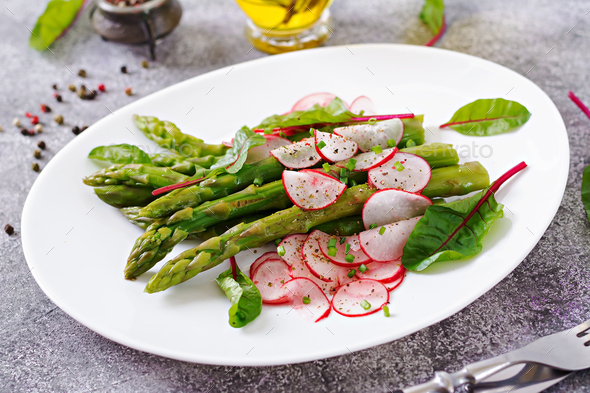 Salad from asparagus with radish and chard. Vegan cuisine. Healthy food. - Stock Photo - Images