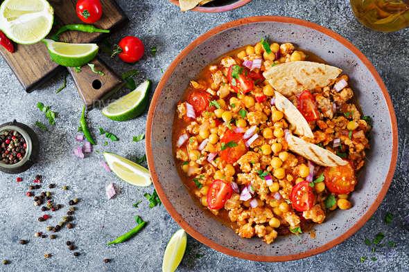Chili con carne of turkey  with chickpeas served with nachos.   - Stock Photo - Images