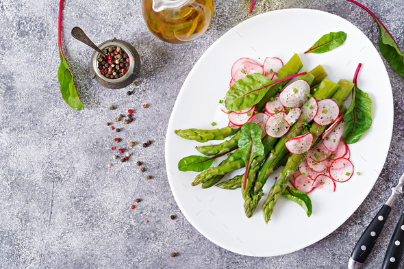Salad from asparagus with radish and chard. Vegan cuisine. - Stock Photo - Images