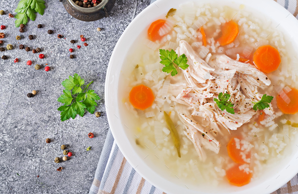 Dietary chicken soup with rice and carrots. Healthy food. Flat lay. Top view - Stock Photo - Images