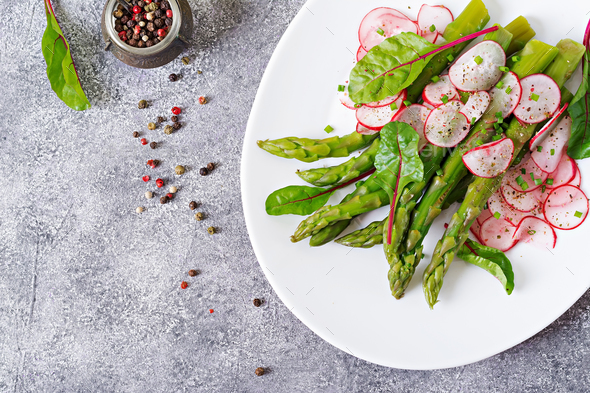 Salad from asparagus with radish and chard. Vegan cuisine. Healthy food. Flat lay. Top view - Stock Photo - Images