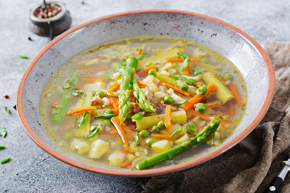 Soup with beef, asparagus, green peas, carrots and celery. Dietary menu. Healthy food. - Stock Photo - Images