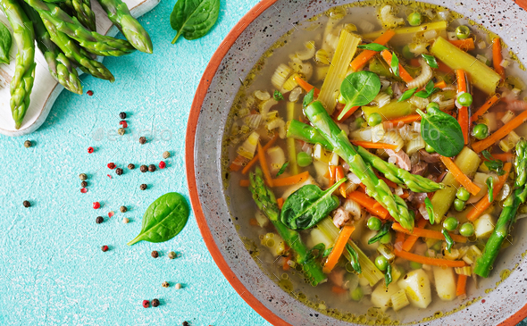 Soup with beef, asparagus, green peas, carrots and celery. Dietary menu.  - Stock Photo - Images