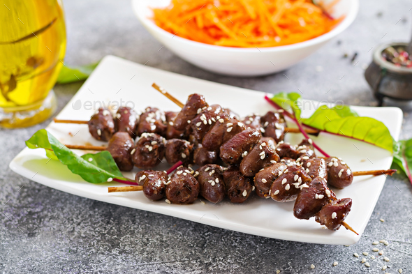 Chicken hearts in spicy sauce and carrot salad. Healthy food. - Stock Photo - Images