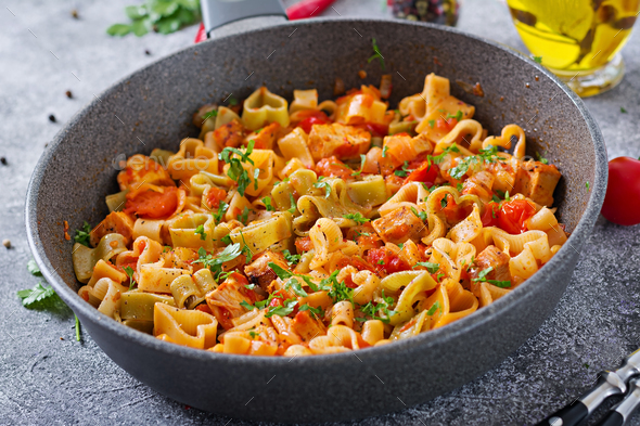 Pasta in the shape of hearts with chicken and tomatoes in tomato sauce. - Stock Photo - Images