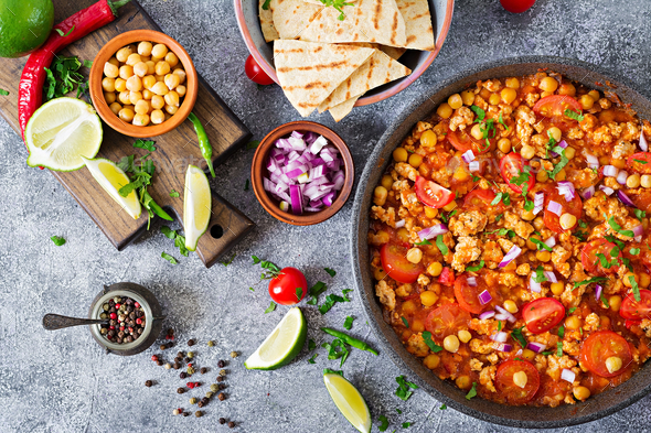 Chili con carne of turkey  with chickpeas served with nachos - Stock Photo - Images