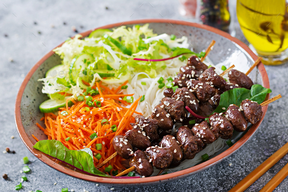 Chicken hearts in spicy sauce, noodles and vegetable salad. Healthy food. - Stock Photo - Images